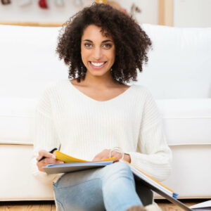 Smiling woman with notebook